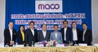 Mana Jantanayingyong, fifth from left, board chairman for Master Ad Public Company Limited (MACO), and Phoon Chiong Kit, fourth from left, attend the company's annual general meeting at a hotel in Bangkok.