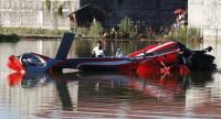 A Filipino on a raft documents the wreckage of a helicopter that crashed in a pond in Malolos City, Bulacan Province, north of Manila, Philippines 25 April.//EPA-EFE