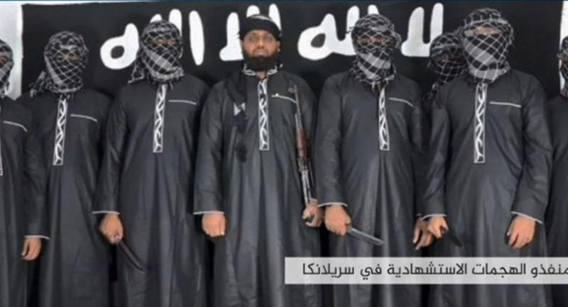The man in the centre is believed to be Zahran Hashim, who was identified by the Sri Lankan police as the leader of the Islamist National Thowheeth Jama'ath (NTJ) group, which Colombo has blamed for the attacks.//AFP