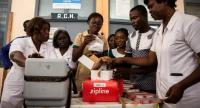 Nurses open boxes with medical supplies delivered by Zipline drones at the New Tafo Government Hospital, in eastern Ghana.