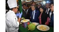 Tun Dr Mahathir (centre) and his wife, Tun Dr Siti Hasmah (second from right), visiting one of the booths at the Malaysia Durian Festival in Beijing Saturday (April 27).