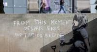 Graffiti artwork, suspected to have been created by the British street artist Banksy, is pictured opposite the environmental protest group Extinction Rebellion's camp at Marble Arch in London on April 26.//AFP