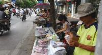In a picture taken on July 16, 2012, vendors display lottery tickets for sale in Hanoi. //AFP