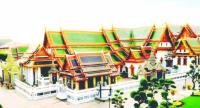 The Phra Maha Monthira group of royal halls – built in close proximity to one another – are marked with distinctive roofs, with tiers telescoping outwards, with decorated pediments featuring undulating Nagas on its gables, and chofa at the apex.