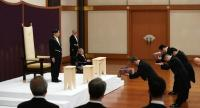 Japan's new Emperor Naruhito (top-L) attends a ceremony to inherit the imperial regalia and seals at the Matsu-no-Ma state room inside the Imperial Palace in Tokyo on May 1.//AFP