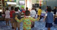A file photo of students at a small school in Si Sa Ket province attend a lesson conducted via distance-learning TV.