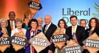 In this file photo taken on April 26, 2019 Liberal Democratic Party leader Vince Cable (C) poses with the party's MEP candidates for the European Parliament election during a launch event in London on April 26.//AFP
