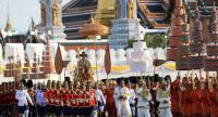 HM King Maha Vajiralongkorn is carried on a palanquin by royal guards during a procession around the old city, aimed at offering subjects a chance to pay homage to their new monarch.  Nation/Wanchai Kraiaoenkhajit