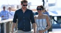(FILES) In this file photo taken on October 22, 2018 Britain's Prince Harry and his wife Meghan, the Duchess of Sussex walk to attend a meet-the-people session at Kingfisher Bay Resort on Fraser Island. // AFP PHOTO
