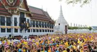 A sea of yellow-clad people gather at the Grand Palace to greet their new monarch when he grants audience from the balcony of the Suddhaisavarya Prasad Throne Hall on Monday (May 6).
