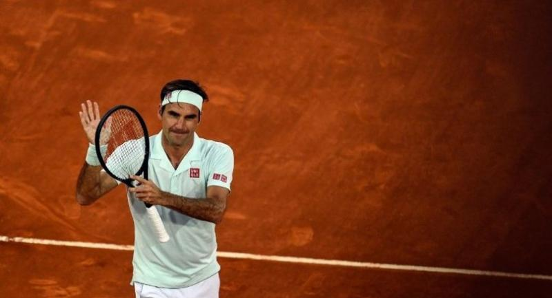 Switzerland's Roger Federer celebrates after winning an ATP Madrid Open round of 64 tennis match against France's Richard Gasquet at the Caja Magica in Madrid on May 7, 2019.