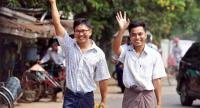Reuters journalists Wa Lone (L) and Kyaw Soe Oo gesture as they walk to Insein prison gate after being freed in a presidential amnesty in Yangon on May 7.//AFP