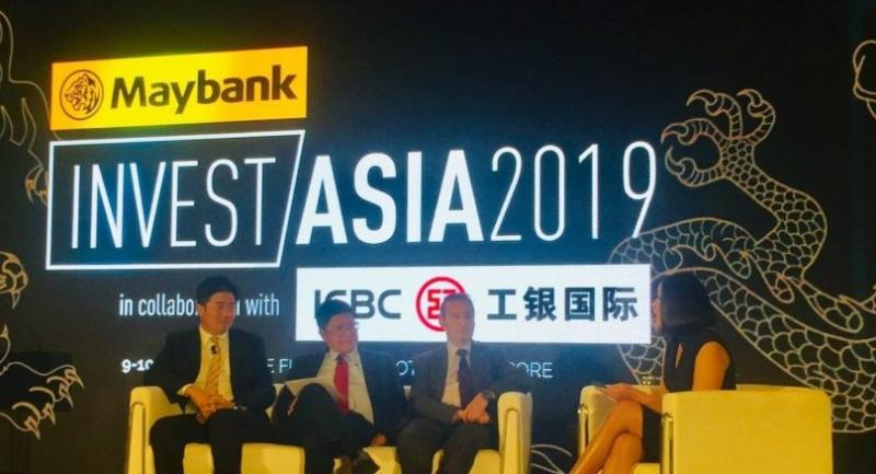 Taking part in a seminar at the InvestAsia2019 conference in Singapore are, from left, Cha Huk Bin, Maybank Kim Eng's regional economist; Tan Kong Yam, deputy chairman (China) of APS Asset Management; and Simon Ogus, DSG Asia's chief executive.