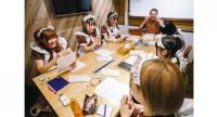 """""""Welcome home, master and princess."""" Women working for a maid cafe learn English in Tokyo's Akihabara district, which is known as a hub for otaku culture and attracts many foreign tourists. /Yomiuri Shimbun"""