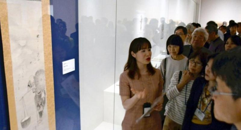 Visitors listen to an explanation of