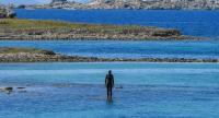 "The statue ""6 times left"" by Gormley stands in the sea at the entrance of the port of the island of Delos in Greece./AFP"