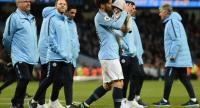 Manchester City's Spanish midfielder David Silva (C) takes part in a lap of appreciation.