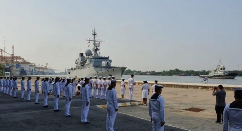 The arrival of the the French frigate, Vendémiaire, on Sunday morning is greeted by the Royal Thai Navy.