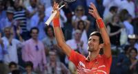 Serbia's Novak Djokovic celebrates after defeating Austria's Dominic Thiem during their ATP Madrid Open semi-final tennis match at the Caja Magica in Madrid. / AFP