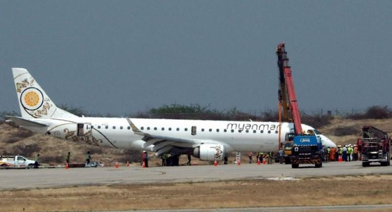 A general view shows a Myanmar National Airlines passenger plane after an emergency landing at Mandalay international airport on May 12, 2019.// AFP PHOTO