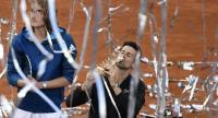 Serbia's Novak Djokovic kisses his trophy after winning the ATP Madrid Open final tennis match against Greece's Stefanos Tsitsipas at the Caja Magica in Madrid on May 12, 2019.