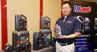Shi Junfeng, chairman of Jiangsu Lopal Tech Co Ltd, presents the company's Trisonic lubricant products at its official launch into the Thai market yesterday.