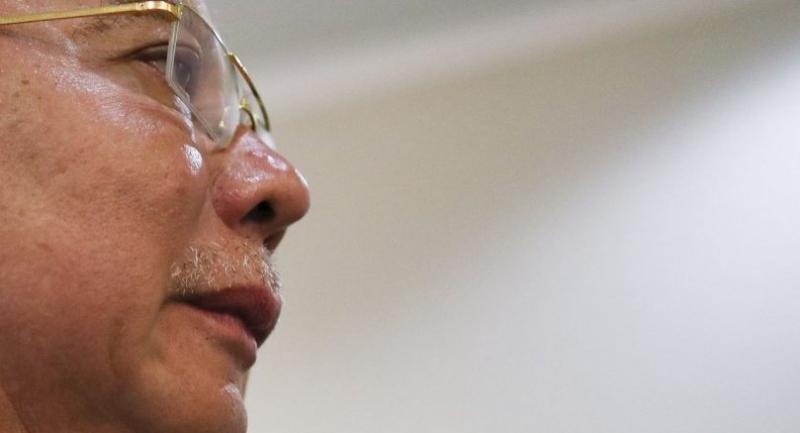 File photo : Former Malaysian Prime Minister Najib Razak looks on as he walks to the court room at the Kuala Lumpur High Court, Malaysia, on May 14.//EPA-EFE