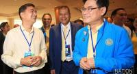 New Democrat party leader Jurin Laksanavisit (right) smiles after winning the internal votes to replace Abhisit Vejjajiva (left) in a party election on Wednesday.