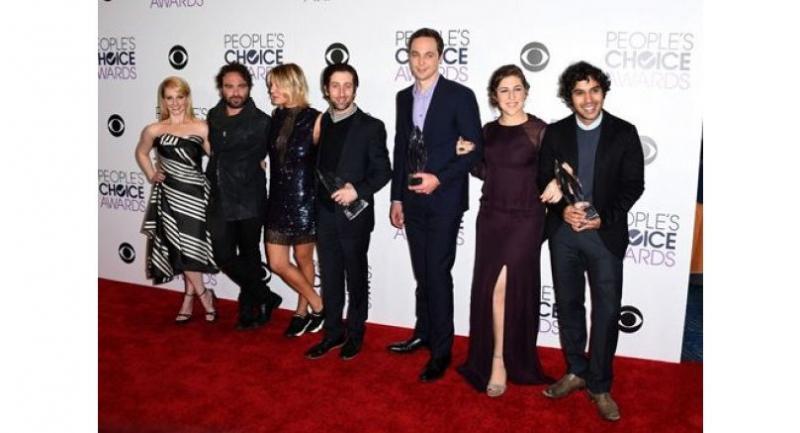 "The cast of ""The Big Bang Theory"", from left Melissa Rauch, Johnny Galecki, Kaley Cuoco, Simon Helberg, Jim Parsons, Mayim Bialik and Kunal Nayyar pose at the 2016 People's Choice Awards."