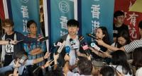 Democracy activist Joshua Wong Chi-fung (C) speaks to members of the media before entering the High Court in Hong Kong, China, 16 May 2019. // EPA-EFE PHOTO