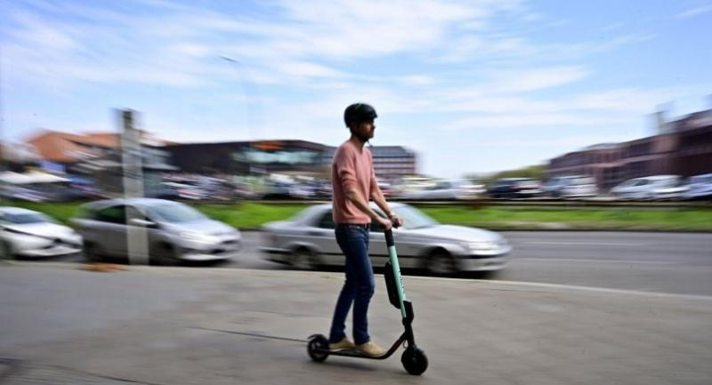 In this file photo taken on April 17, 2019 A man rides an E-Scooter of rental company Tier in Berlin on April 17.//AFP