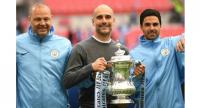 Serial winner: Pep Guardiola's Manchester City claimed the first ever domestic treble in English football AFP / Daniel LEAL-OLIVAS