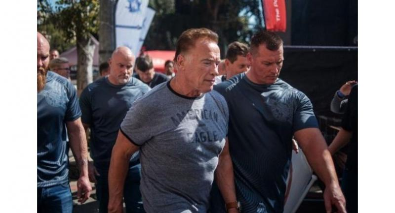 Hollywood star Arnold Schwarzenegger was chatting with fans at the Sandton Convention Centre in Johannesburg when a man took a flying leap and kicked him high in the back.PHOTO: AFP