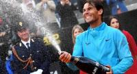 Rafael Nadal of Spain celebrates after defeating Novak Djokovic of Serbia in their men's singles final match at the Italian Open tennis tournament in Rome, Italy, 19 May 2019.