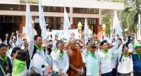"Monks, patients and renowned advocates demand free access to marijuana-based medicines before starting the 268km ""Cannabis Walk"" from Vachira Bhodiyan Forest Temple in Phichit province yesterday."