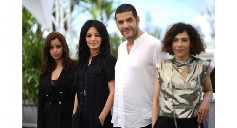 """Moroccan actress Nisrin Erradi, Moroccan film director Maryam Touzani, Moroccan producer Nabil Ayouch and Moroccan actress Lubna Azabal pose during the photocall for """"Adam"""" at the Cannes Film Festival in Cannes."""