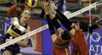 Elena Pietrini (ITA) from Italy spikes against Amporn Hyapha (THA) and Piyanut Pannoy (THA) from Thailand. / FIVB