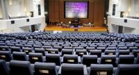 Officials yesterday prepare the conference hall at TOT headquarters for the convening of the House of Representatives tomorrow. The session will elect the house speaker and deputies.