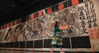 An historic manga curtain painted by Japanese artist Kawanabe Kyosai for the Shintomi Theatre stage is part of the exhibition at the British Museum in London. /AFP