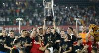 Valencia players celebrate with their trophy after winning the 2019 Spanish Copa del Rey (King's Cup) final football match./ AFP