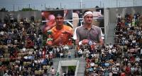 Switzerland's Roger Federer (R) and Italy's Lorenzo Sonego drink during a break. / AFP