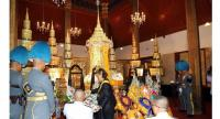Her Royal Highness Princess Maha Chakri Sirindhorn presides over the royally sponsored bathing rites for statesman General Prem Tinsulanonda at Benchamapobhit Temple yesterday evening.