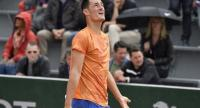 Bernard Tomic of Australia plays Taylor Fritz of the USA during their men's first round match during the French Open tennis tournament at Roland Garros in Paris. / EPA