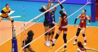 Thailand block a drop shot from a Chinese player. / FIVB Photo