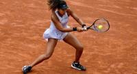 Japan's Naomi Osaka returns the ball to Slovakia's Anna Karolina Schmiedlova. / AFP