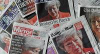 File photo : UK daily newspapers photographed as an illustration in London on May 25 shows front page headlines reporting on the resignation speech of Britain's Prime Minister Theresa May.//AFP