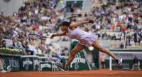 Japan's Naomi Osaka plays a backhand return to Belarus' Victoria Azarenka. / AFP