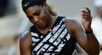 Serena Williams of the US reacts during her women's singles third round match against Sofia Kenin of the US. / AFP