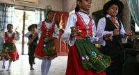his picture taken on May 11, 2019 shows students dressed in traditional Portuguese outfits dancing before learning the Kristang language at the Portuguese Settlement in Ujong Pasir, Malacca.//AFP