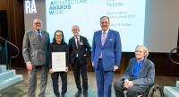Boonserm, second from left, holds the Royal Academy Dorfman Award with the award's jury at the Royal Academy of Arts in UK on May 17, 2019.